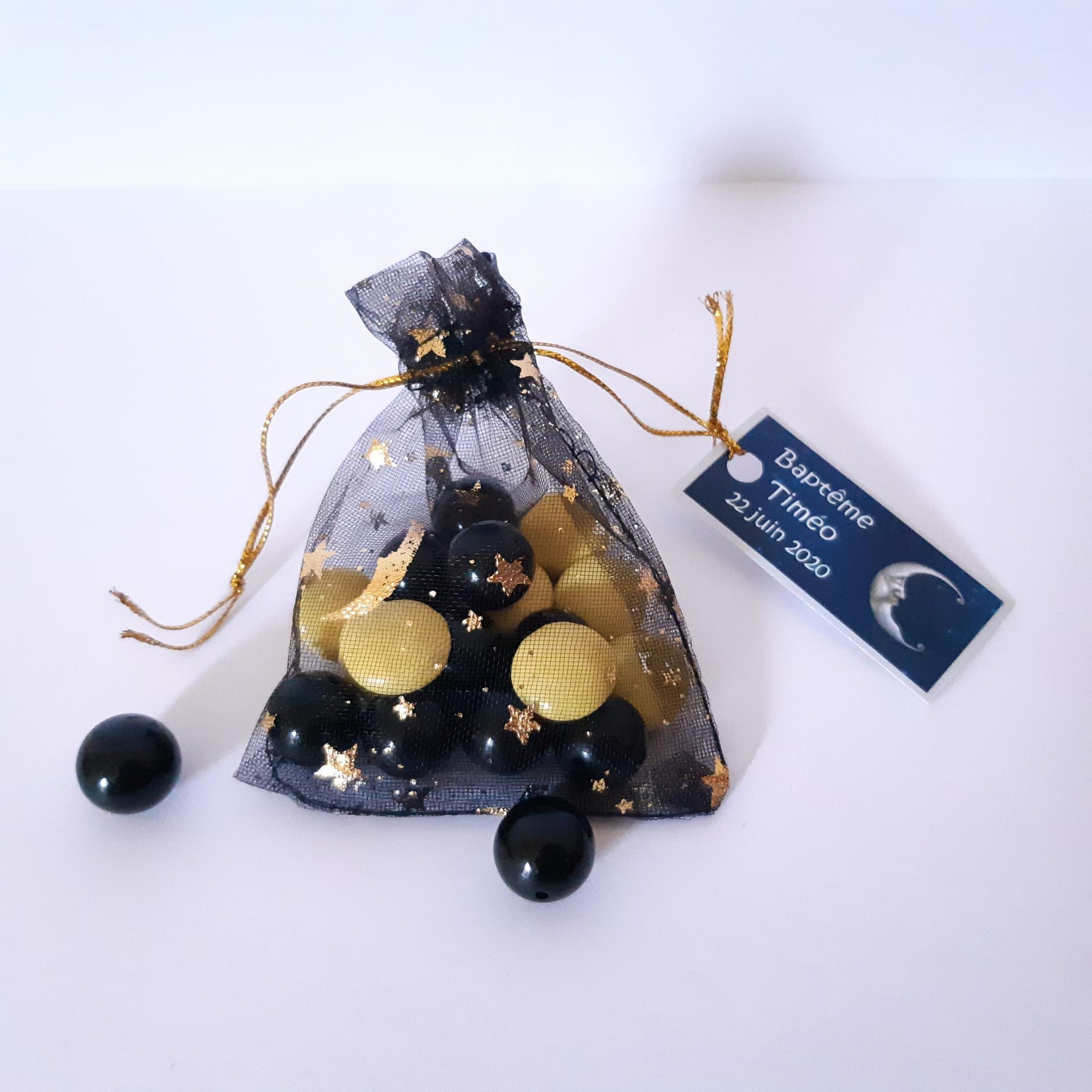 pochon dragées noir avec étoiles dorées avec étiquette lune